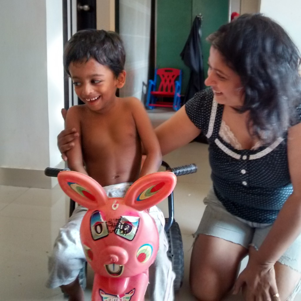 Nisarga on his tricycle and Vidyut
